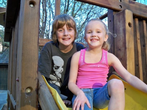 My kids four years ago during a visit from my niece and nephew: Our poor, forgotten swing set was happy to welcome them back.